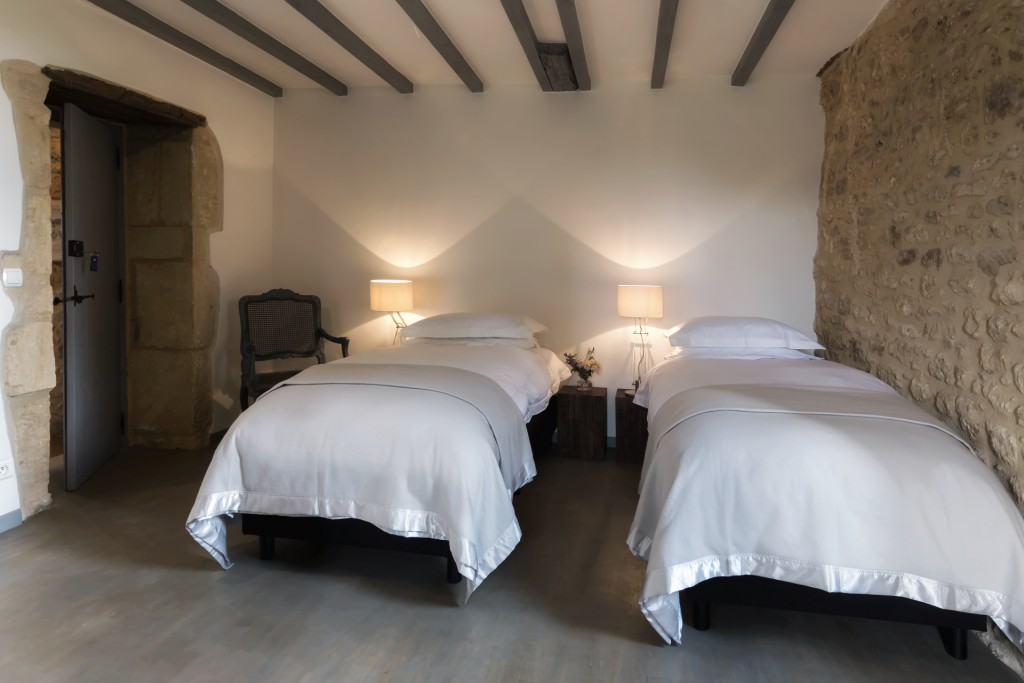 Twin beds in Bedroom 5 of Le Mas, a large holiday home in the Dordogne