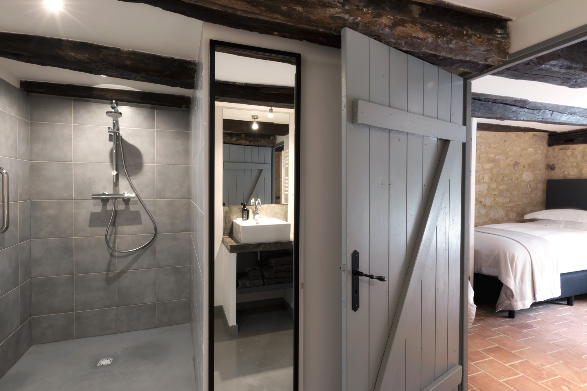 Bedroom 4 and its en suite bathroom with walk-in shower, in Le Mas, a large holiday home near Sarlat in the Dordogne
