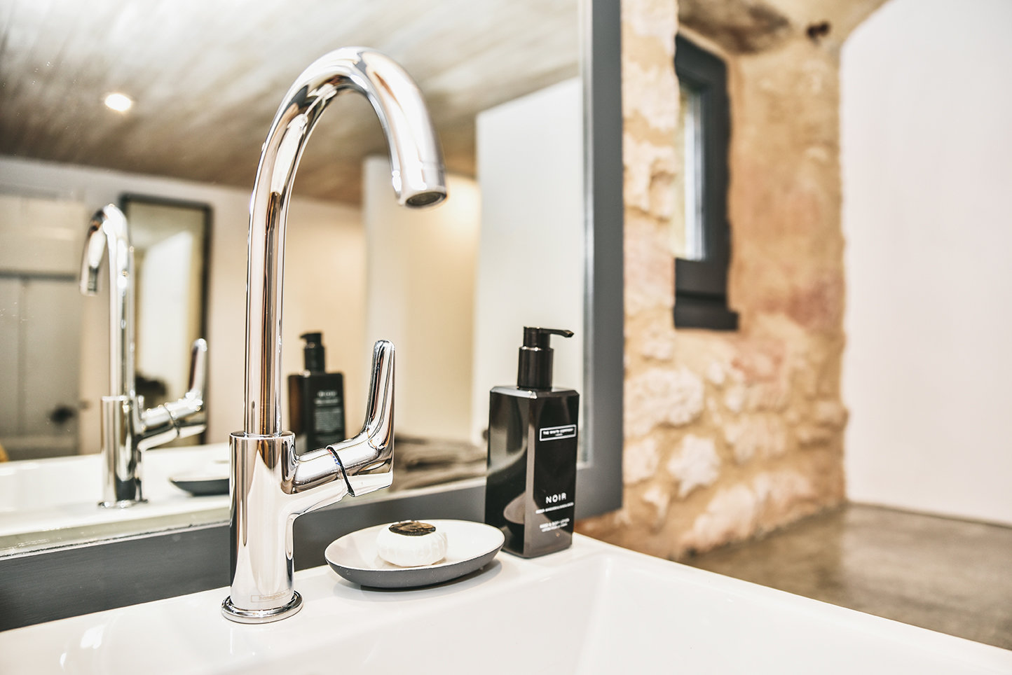 Glistening chrome taps on a white sink in a bathroom in the 4-star holiday cottage in the Dordogne, Le Mazet