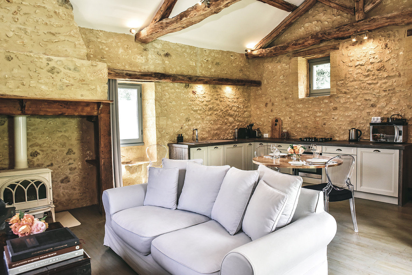 The sitting room and kitchen of Le Mazet, a rental cottage in the Dordogne