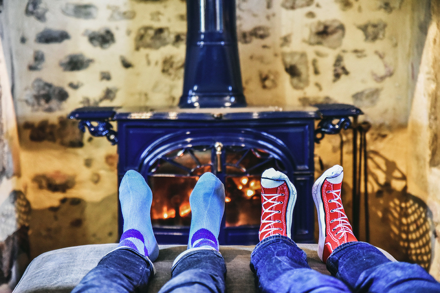 Warming your feet in front of a roaring fire in the sitting room of Le Mas, a spacious holiday home in the Dordogne