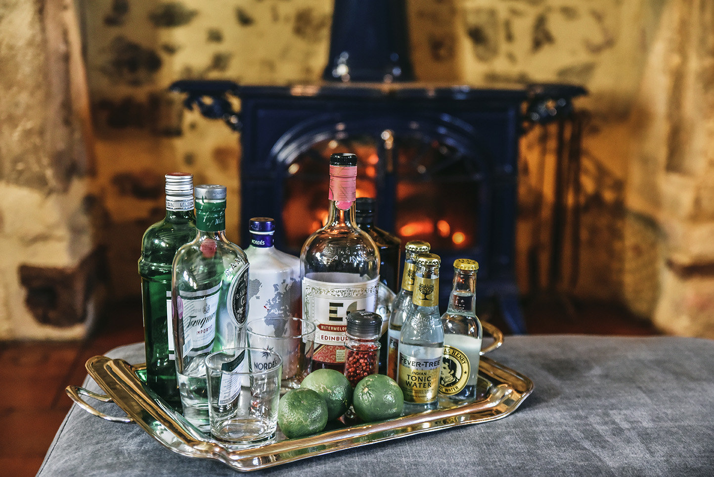 In the sitting-room of Le Mas, in front of a roaring fire, is a tray with a range of gins, tonics and limes
