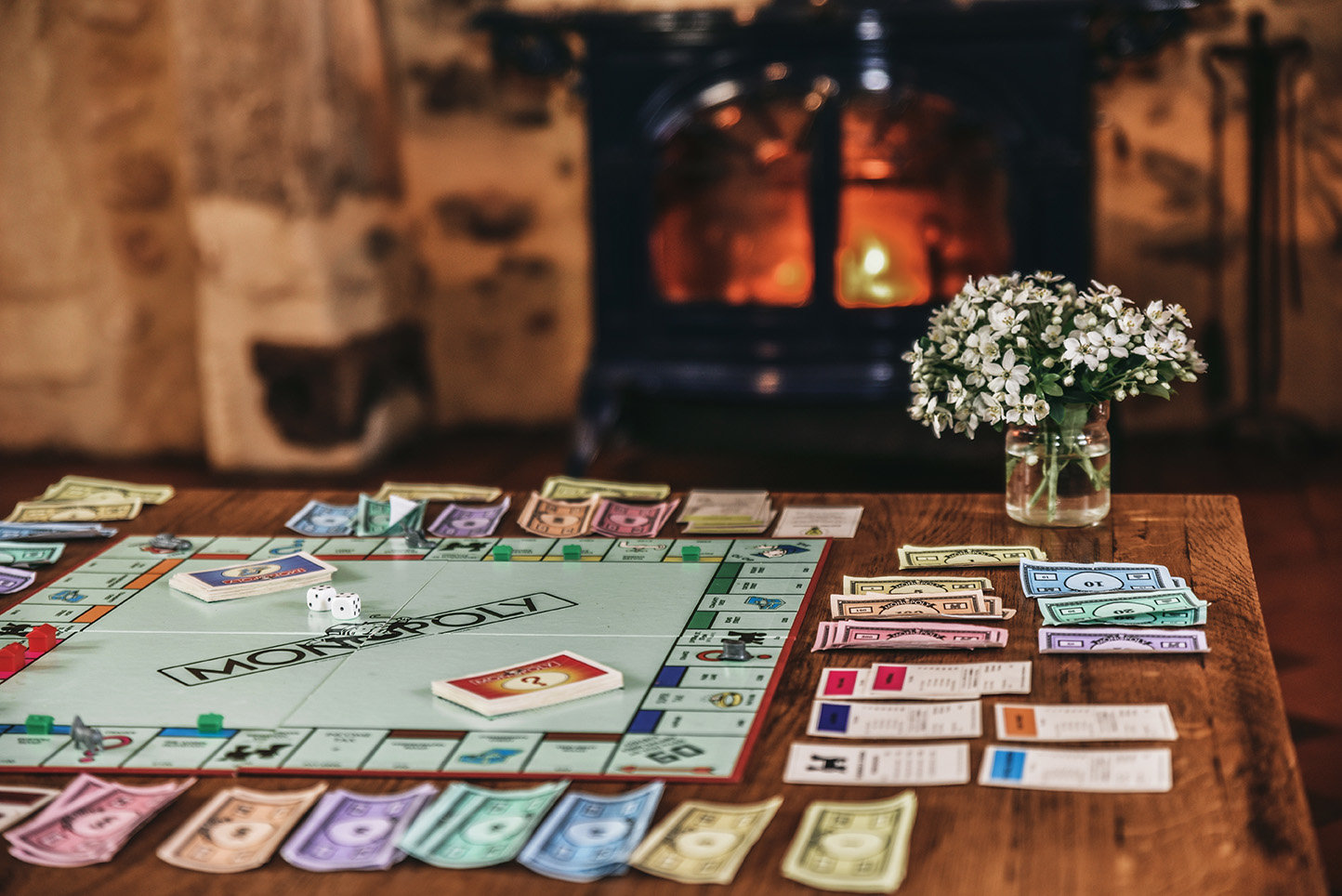 Playing Monopoly in front of a roaring fire at Le Mas, a luxury 5-bedroom family holiday home in the Dordogne