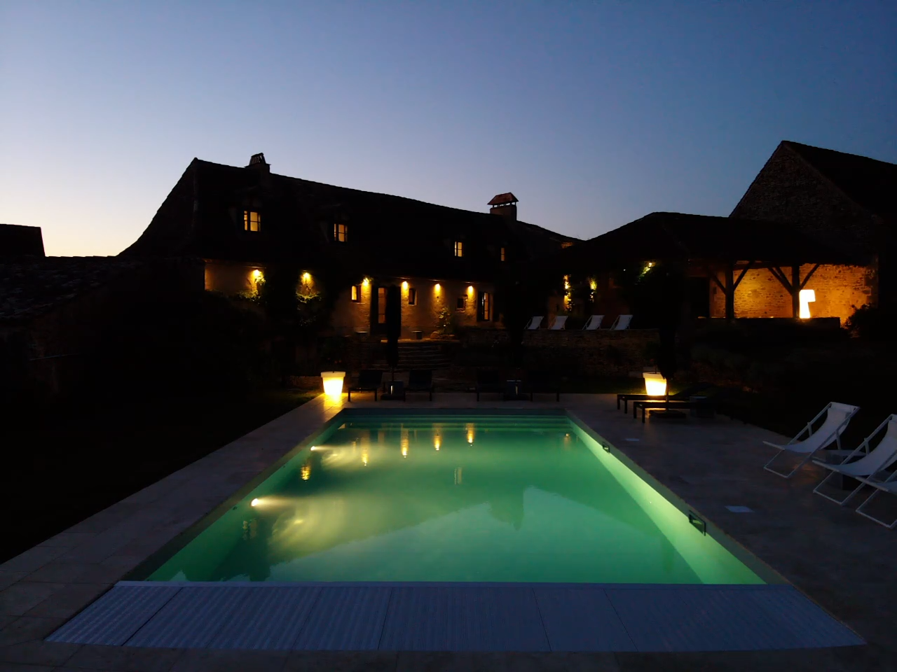 Luxury holiday house with private pool in the Dordogne lit at night