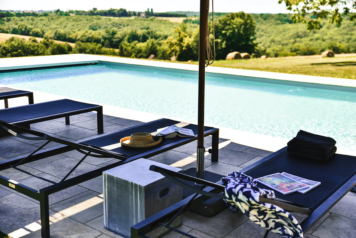 Luxury gîte with private heated pool overlooking the Dordogne countryside with sun loungers and parasols